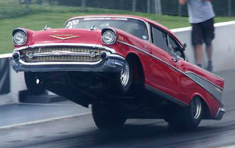 57-chevy-wheelie-red.jpg